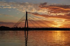The cable-stayed bridge. Silhouette of a cable-stayed bridge in Riga against a beautiful sunset Royalty Free Stock Images