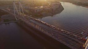 The cable-stayed bridge at sunset. Cable-Stayed Bridge in St.Petersburg at sunset. it is go cars and trucks. Aerial view from the top of bridge. SAINT-PETERSBURG stock video footage