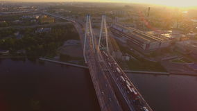 The cable-stayed bridge at sunset. Cable-Stayed Bridge in St.Petersburg at sunset. it is go cars and trucks. Aerial view from the top of bridge. SAINT-PETERSBURG stock video