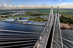 Cable stayed bridge under construction, and a berth for ships. Stock Photos