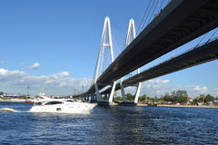 Cable-stayed bridge and yacht sailing on the Neva Royalty Free Stock Images