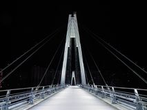 Cable-stayed pedestrian bridge in the night Royalty Free Stock Photo