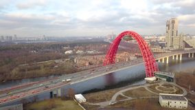 Cable stayed picturesque bridge over Moscow river and car traffic drone view. Cable stayed picturesque bridge over Moscow river and car traffic on background stock video