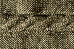 Cable stitch forest green. Close up of bavarian knitting pattern, pure wool, horizontal and dark green Royalty Free Stock Photography