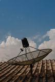 Cable telecom. Satellite dishes on the roof of house  in the evenig Stock Photography