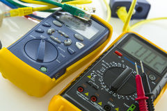 Cable tester and multimeter. Copper cable qualification tester and multimeter Royalty Free Stock Photo