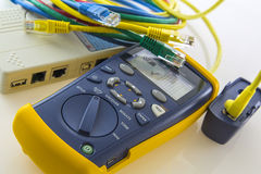 Cable tester troubleshoots and qualifies cabling speed. Copper cable qualification tester troubleshoots and qualifies cabling speed Stock Images