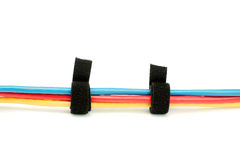Cable tied ethernet cables. Red yellow and blue ethernet cables with a black cable tie Royalty Free Stock Photos