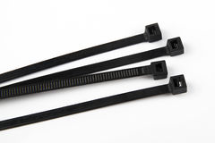 Cable ties in black. In front of white background Stock Photo