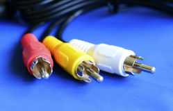 Cable to the TV  on blue Stock Images