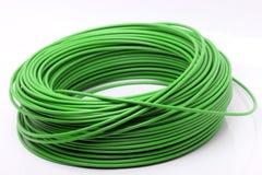 Cable verde en el fondo blanco Imagen de archivo libre de regalías