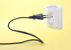 Cable with wall outlet Stock Photos