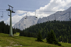 Cable way in the beautiful background off the alps Stock Image