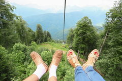 Cable way Legs of man and woman Stock Photos