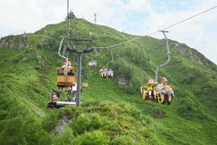 Cable way is serving ski-run with vertical drop. KRASNAYA POLYANA - Jule, 17: Cable way is serving ski-run with vertical drop 1687 m and length 9,5 km benefit Royalty Free Stock Photo