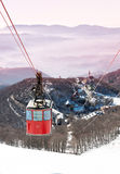 Cable-way on snowy italian mountains at dusk Stock Images