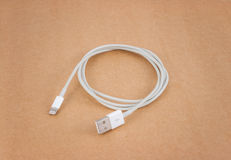 Cable wire charger on brown paper Stock Image