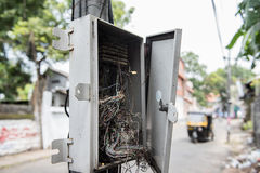 Cable Wires in Electric Box. An electric cable box on the street side in Thiruvananthapuram, Kerala. The box is open and electric wires are seen in a messy Royalty Free Stock Image