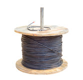 Cable in wood roll. Black electric cable wires in wood roll isolated on white background with clipping path Royalty Free Stock Image