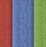 Cabled knitted pattern 3 colours Stock Photos