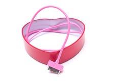 Cabler rosa del telefono cellulare isolato fotografia stock libera da diritti