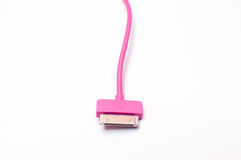 Cabler rosa del telefono cellulare isolato immagini stock
