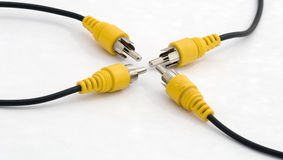 Cables. Computer and audio cables colored black, yellow,and white Stock Images