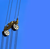 Cables. Counterbalance and traction system of an heavy crane against a clear blue sky.Available room for latter text Royalty Free Stock Image