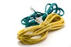 Cables amarillos y verdes de la red atados juntos Fotografía de archivo