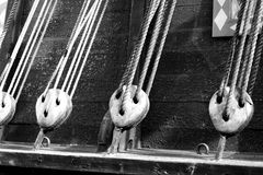 Cables of an ancient ship stock photos