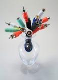 Cables audios en un florero Imagen de archivo libre de regalías