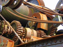 Cables and Cogs. The rusting winch and gears of a mobile railway crane Royalty Free Stock Photography