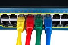 Cables coloreados de la red conectados con el interruptor Foto de archivo libre de regalías
