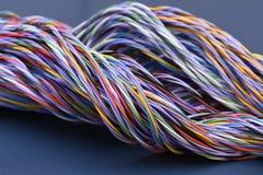 Cables coloreados de las telecomunicaciones Imágenes de archivo libres de regalías