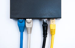 4 cables connected to the router Stock Photos