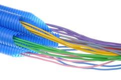 Cables de cobre eléctricos coloreados para el electricista en tubos acanalados Imágenes de archivo libres de regalías