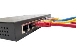 Cables de la red conectados con el router Foto de archivo libre de regalías