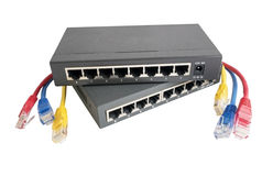 Cables de la red conectados con el router Fotos de archivo libres de regalías