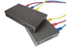 Cables de la red conectados con el router Imagen de archivo libre de regalías