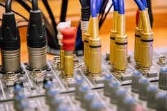 Cables entering mixer table perspective view blurred stock image