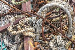Cables and fishing nets cramped together. Cables and fishing nets stored in a steel cage royalty free stock photo
