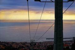 Cables of a funicular from Monte to Funchal at sunset. Madeira, Portugal. Cables of a funicular from Monte to Funchal at sunset. Portuguese island of Madeira royalty free stock photography