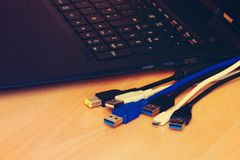 Cables and laptop royalty free stock photos
