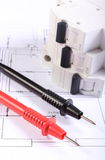Cables of multimeter and electric fuse on construction drawing Stock Image