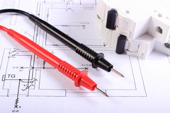 Cables of multimeter and electric fuse on construction drawing Stock Photography