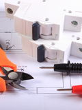 Cables of multimeter and electric fuse on construction drawing Royalty Free Stock Photography