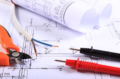 Cables of multimeter, pliers, electric wire and construction drawing Royalty Free Stock Images