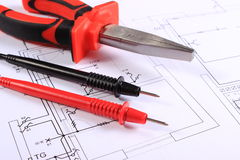 Cables of multimeter and work tool on construction drawing Stock Photography