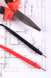 Cables of multimeter and work tool on construction drawing Royalty Free Stock Photo