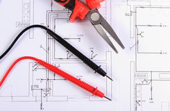 Cables of multimeter and work tool on construction drawing Stock Photos